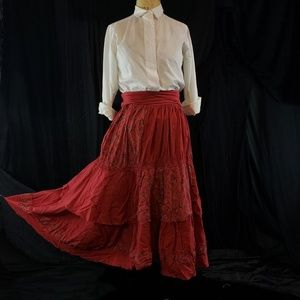 Lovely  pink hued brick red layed skirt.